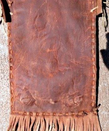 Pueblo-hide-bandolier-bag-silver-concho-back